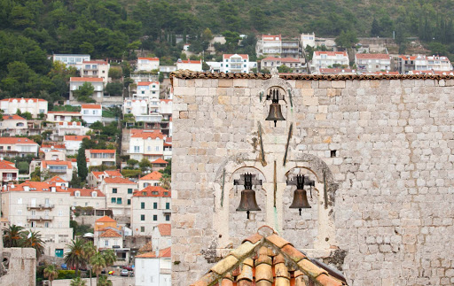 Dubrovnik-bells.jpg - A bell tower in Old Dubrovnik looks out over more modern houses.