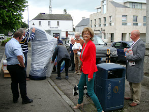 Photo: In Blessington Square preparing Harry's harp for transit. Margaret Kennedy the lovely lady in red really brightens up this picture.