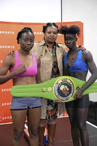 Smangele Hadebe, left, BSA's Women in Boxing committee chairperson Matilda Kabini and Ellen Simwaka at the weight-in for their ABU SADC title fight tonight.