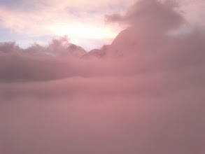 Photo: The pyramid peak of Everest breaking from the clouds