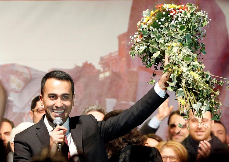 5-Star Movement leader Luigi Di Maio speaks to supporters in Pomigliano D'Arco, Italy, March 6, 2018. REUTERS