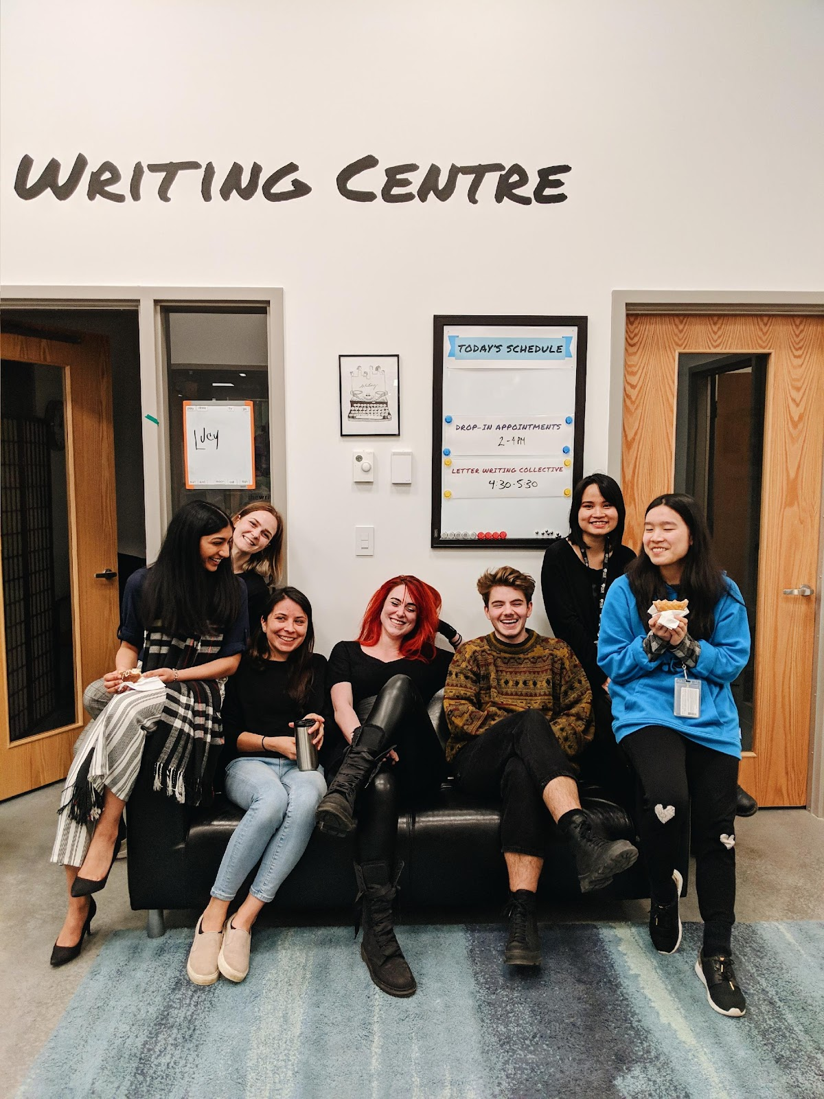 Image of people laughing on a couch in the Writing Centre