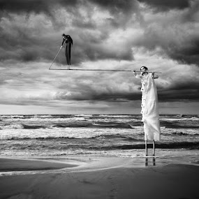Acrobats by Dariusz Klimczak - Digital Art People ( black and white, stilts, mood, sea, square, beach, men, surreal, klimas )