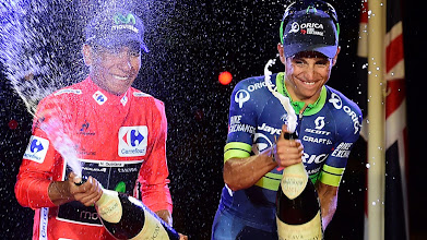 "Photo: Winner of La Vuelta 2016, Movistar's Colombian cyclist Nairo Quintana (C), second Sky's British cyclist Christopher Froome (L) and third placed Orica-Bikeexchange's Colombian cyclist Esteban Chaves celebrate on the podium of the last stage of the 71st edition of ""La Vuelta"" Tour of Spain, a 104.8km route Las Rozas to Madrid, on September 11, 2016. / AFP PHOTO / JOSE JORDAN CYCLING-ESP-TOUR-VUELTA"