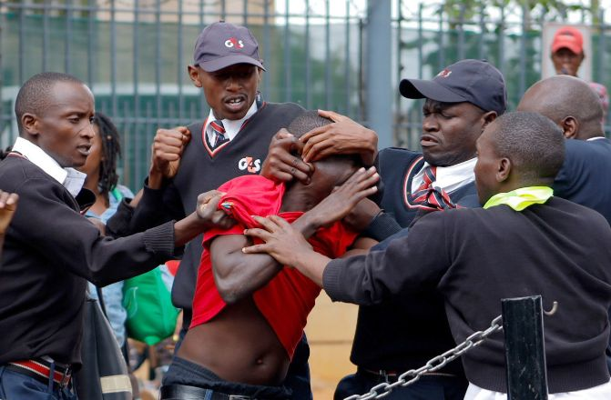 A refugee is roughed up by G4S security guards outside the UNHCR building in Westlands on May 10, 2019