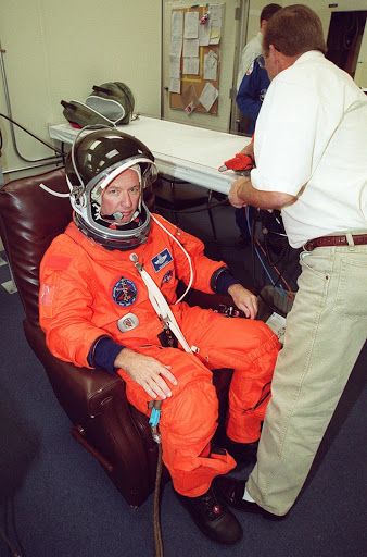 Commander Brian Duffy solemnly undergoes suit check before heading out to the Astrovan for the ride to Launch Pad 39A.