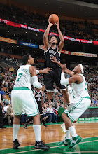 Photo: BOSTON, MA - OCTOBER 16:  Josh Childress #2 of the Brooklyn Nets shoots the ball against Jared Sullinger #7 and Paul Pierce #34 of the Boston Celtics on October 16, 2012 at the TD Garden in Boston, Massachusetts. NOTE TO USER: User expressly acknowledges and agrees that, by downloading and or using this photograph, User is consenting to the terms and conditions of the Getty Images License Agreement. Mandatory Copyright Notice: Copyright 2012 NBAE  (Photo by Brian Babineau/NBAE via Getty Images)