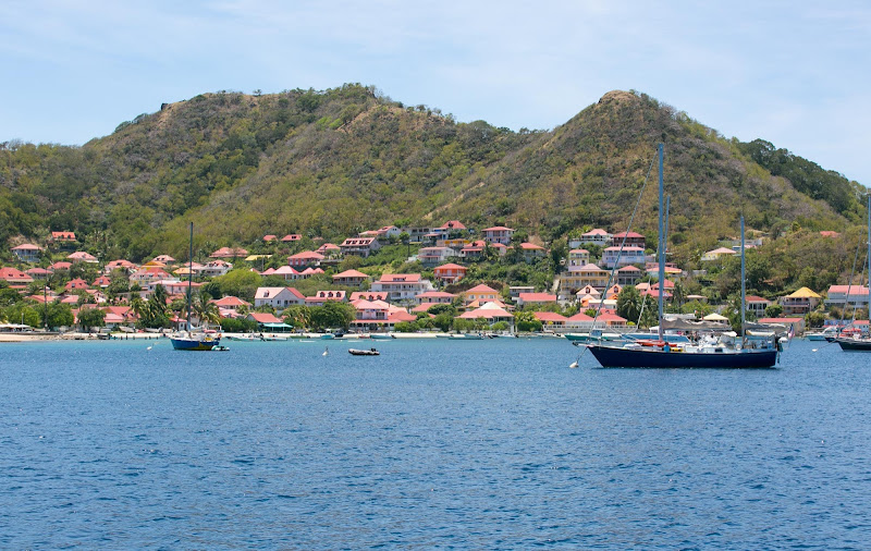 Pretty red-tiled houses line the waterfront of Îles des Saintes, Guadeloupe.