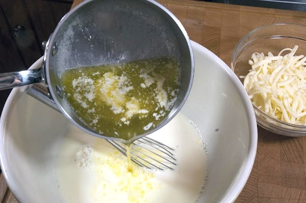 Slowly add the melted butter, and whisk while adding.