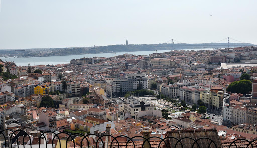 lisbon-cityscape-bridge2-1.jpg - Overlooking Lisbon from the key park, lovers put locks on fence and throw key away.