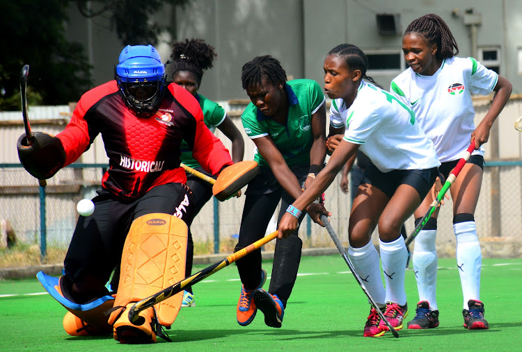 Kenya's Grace Bwire (2nd R) and Naomi Kemunto challenge the Ugandan defence during their test match at the Sikh Union ground on Thursday.