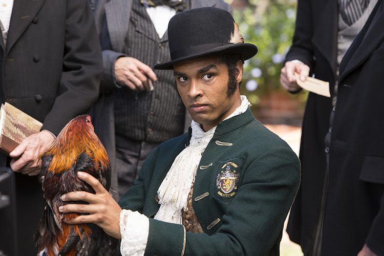 Regé-Jean Page charms a chicken in Roots.