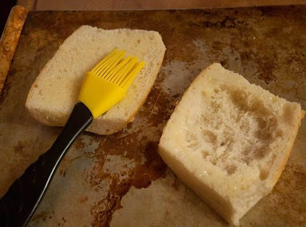 Brush some melted butter on the cut side of the top half, and around...