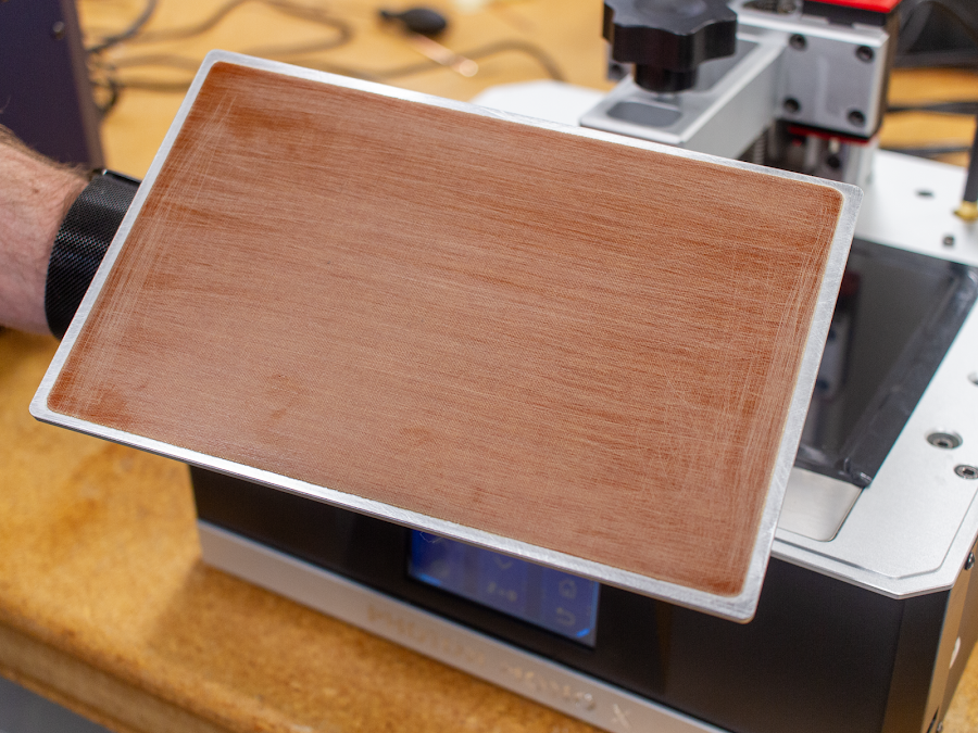 Having a sanded surface plays a major roll in the successful bond between the build surface and 3D printing material.