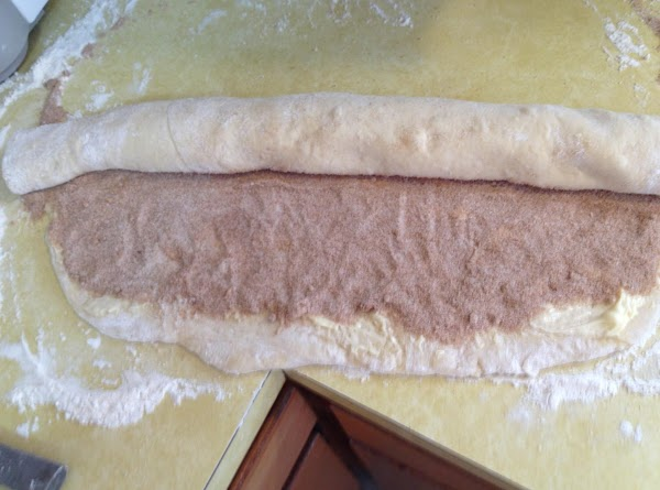 "Starting at the top, roll the dough down toward you, keeping it fairly ""tight""...."