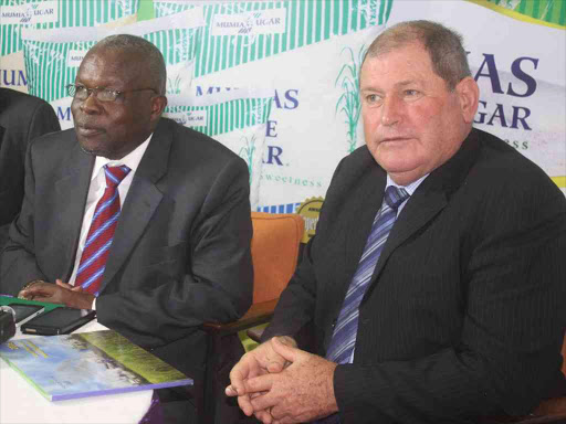 Mumias Sugar Company chairman Dan Ameyo with CEO Errol Johnston during the annual general meeting in Kisumu on December 9 last year /MAURICE ALAL