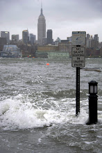 Photo: The Hudson River swells and rises over the banks of the Hoboken, New Jersey waterfront.