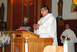 Photo: The Gospel proclaimed first in Spanish by Deacon Victor Rivero