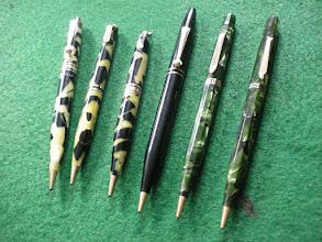 """Photo: Eversharp plastic pencils from the 1930's  The four from the left are from the """"Equipoise"""" range, introduced in 1929 for only a short time to compete against the trend away from flat-top pencils and to compete with Parker's """"Streamline"""" range and Sheaffer's """"Balance"""" range - both of which came out earlier and also had more curvy shapes. The black pencil is from the scarce first-production model of 1929 which had a short life.   The two right-hand pencils are from the """"Doric"""" range (so-called because the pens had 12 sides, as did the Greek columns of that name) introduced in 1931. As with all Eversharps these were produced in different colours - these being Kashmir Green.  A number of these pencils have the Eversharp gold seal, double-tick quality mark - their sign of top quality."""