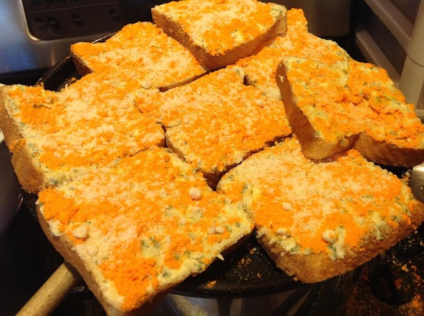 Spread the softened butter mixture over each piece of bread. Then sprinkle each evenly...