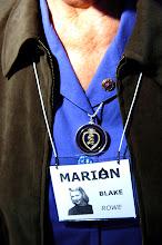Photo: Marian Blake Rowe wears her son's Purple Heart.  Major Alan Blake Rowe, a career Marine, was killed in Iraq in Sept. '04