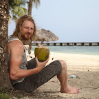 Enjoying the local beach coctail - Coco Loco, 50/50 rum with fresh coconut milk