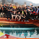 Mark Webber does a back flip into the pool after winning in Monaco