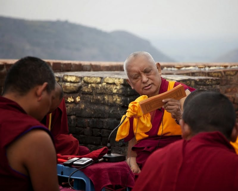 Lama Zopa Rinpoche giving the oral transmission of the Vajra Cutter Sutra on Vulture's Peak, India, March 2014. Photo by Andy Melnic.