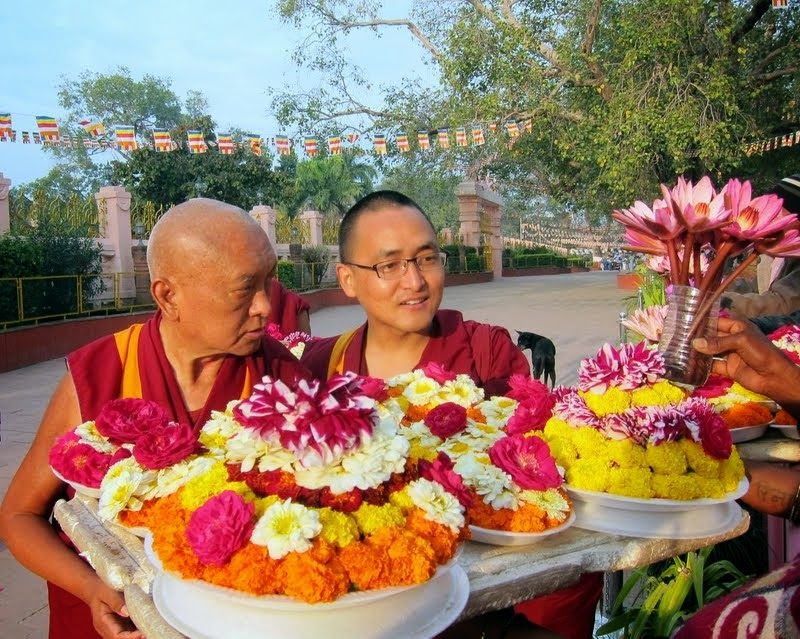 Lama Zopa Rinpoche buying extensive flower offerings at the Mahabodhi Stupa, Bodhgaya, India, February 2014. Photo by Ven. Sarah Thresher.