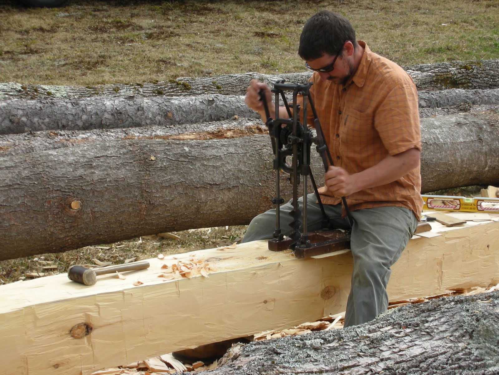 Seth drills out mortises for the stub tenons.