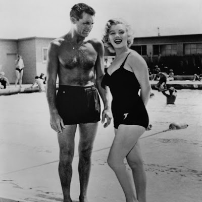 ca. 1952 --- Marilyn Monroe with Cary Grant --- Image by © Bettmann/CORBIS