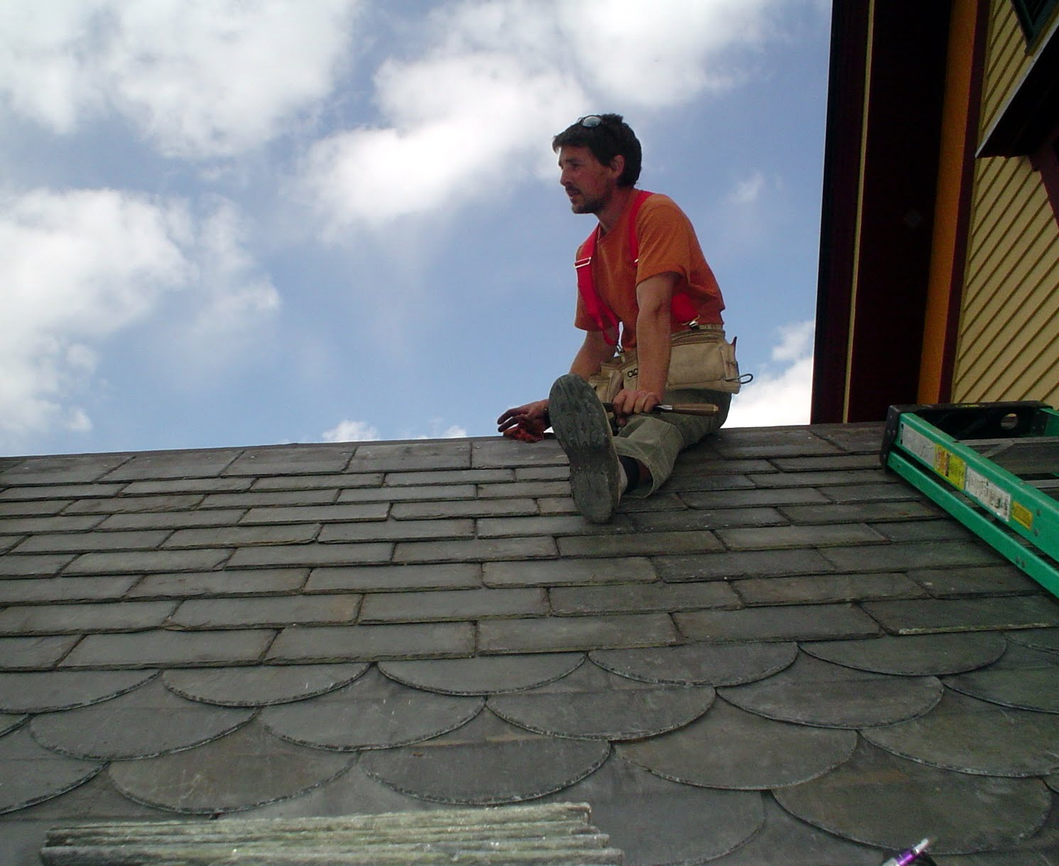 Seth Kelley nears completion of the first side of the roof.