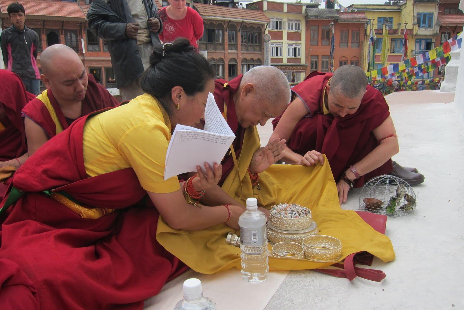 Rinpoche and Khadro-la offering mandala at Bouddha Stupa. With Ani. Jan. Photo by Ven.Sarah Thresher. April 18, 2013