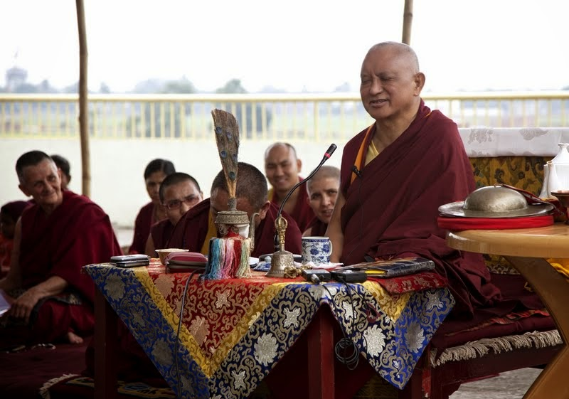 Lama Zopa Rinpoche doing a Padmasambhava incense puja with Sangha on the roof of Root Institute, Bodhgaya, India, March 2014. Photo by Andy Melnic.