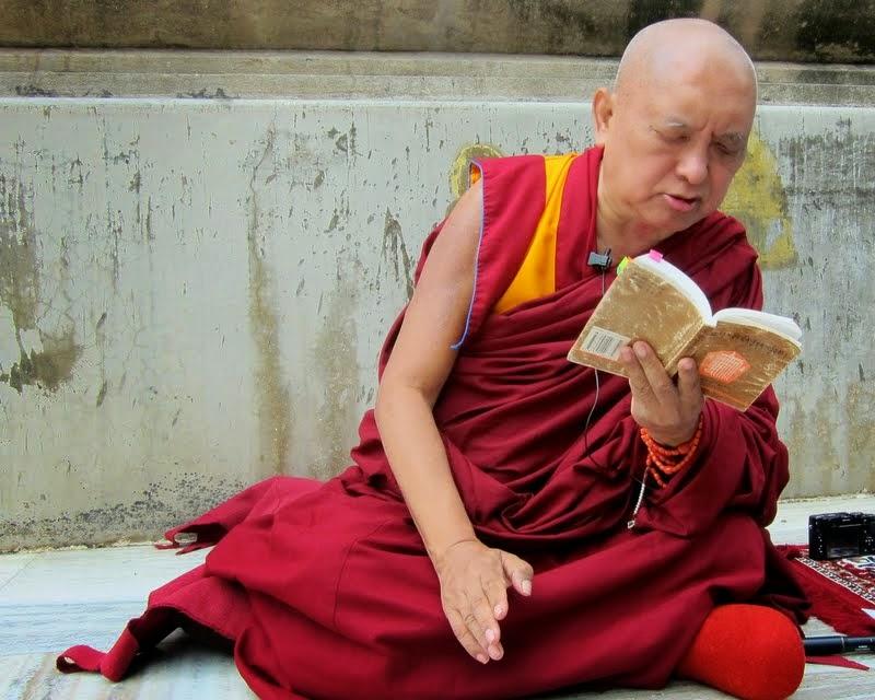 "LamaZopaRinpochegivingoraltransmissionof""KingofPrayers""atMahabodhi Stupa, Bodhgaya, India, February 2014. Photo by Ven. Sarah Thresher."