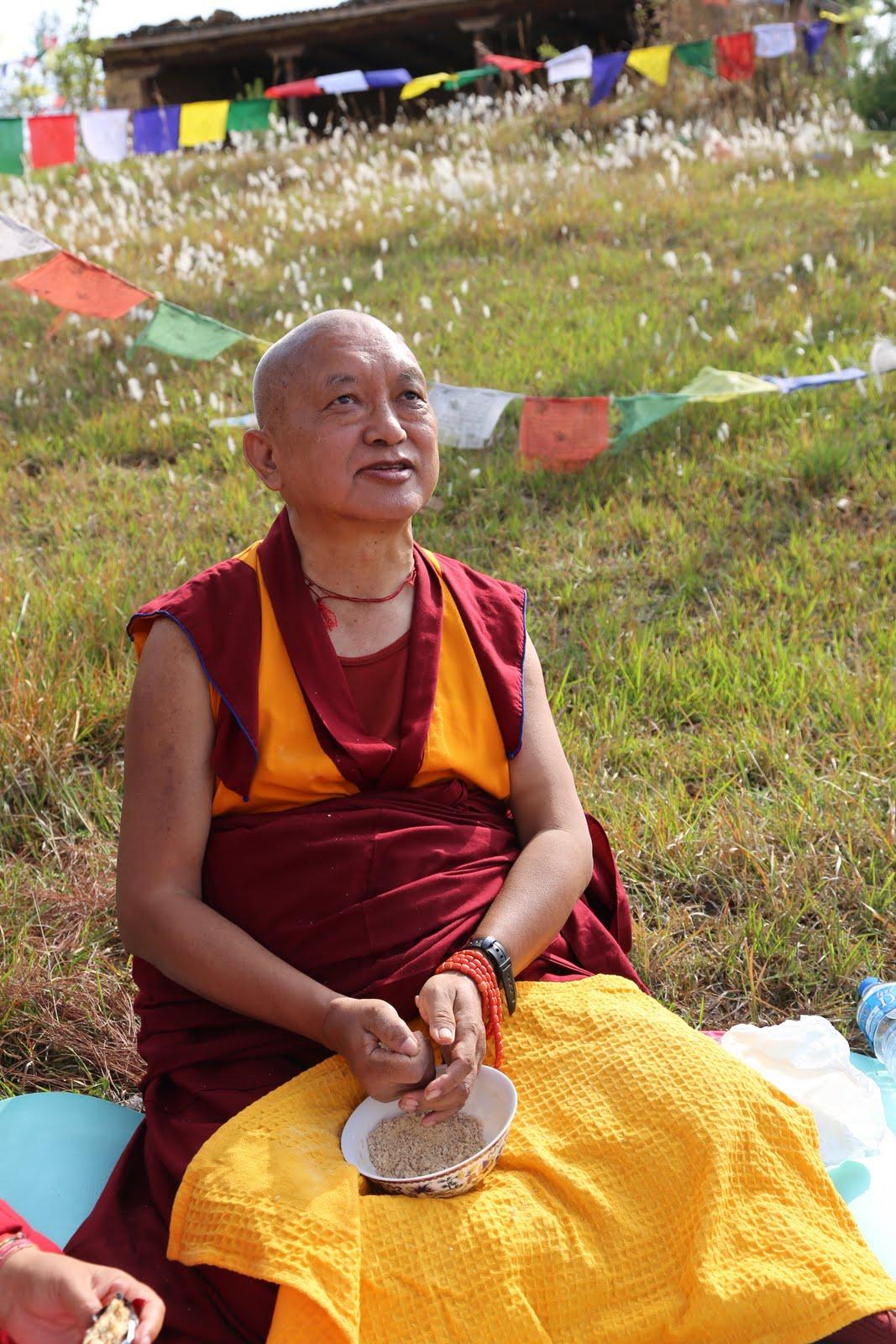 Rinpocheeatingpuk(tsampa)3hoursroughdriveaboveNamoBuddhahighaboveKathmandu whereGuruRinpocheissaidtohavesubduedspirits.Photo by Ven.ThubtenKunsangMay7, 2013.