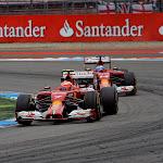 Kimi Raikkonen leads Fernando Alonso, Ferrari F14T