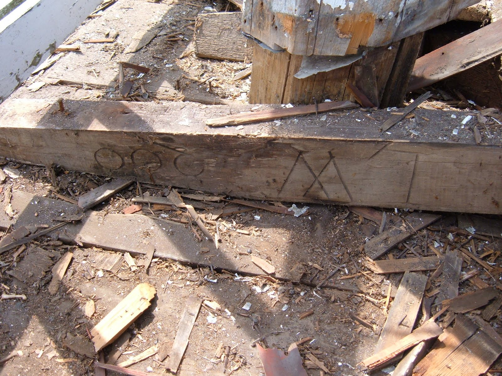 The bell deck had two layers.  The top of the bell deck was rotting and needed to be reboarded.  The initials shown here belong to the sawyer who supplied the milled wood for the project.  These initials had remained hidden for almost two hundred years before we happened upon them.    The sawyers brother was the architect of the meetinghouse whose initials can be found at the base of one of the octagon posts below the bell deck.