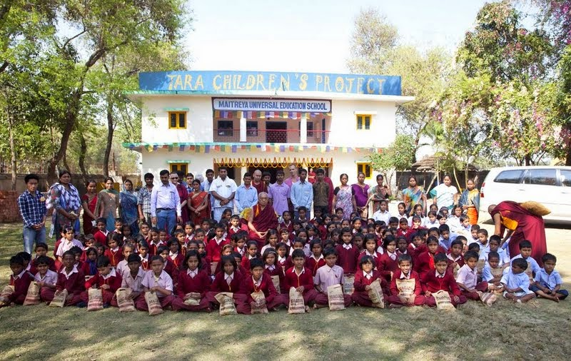 Lama Zopa Rinpoche with children from Maitreya School and Tara Children's Home at Root Institute, Bodhgaya, India, March 2014. Photo by Andy Melnic.