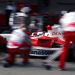 Jarno Trulli (ITA) Toyota TF106 makes a pit stop