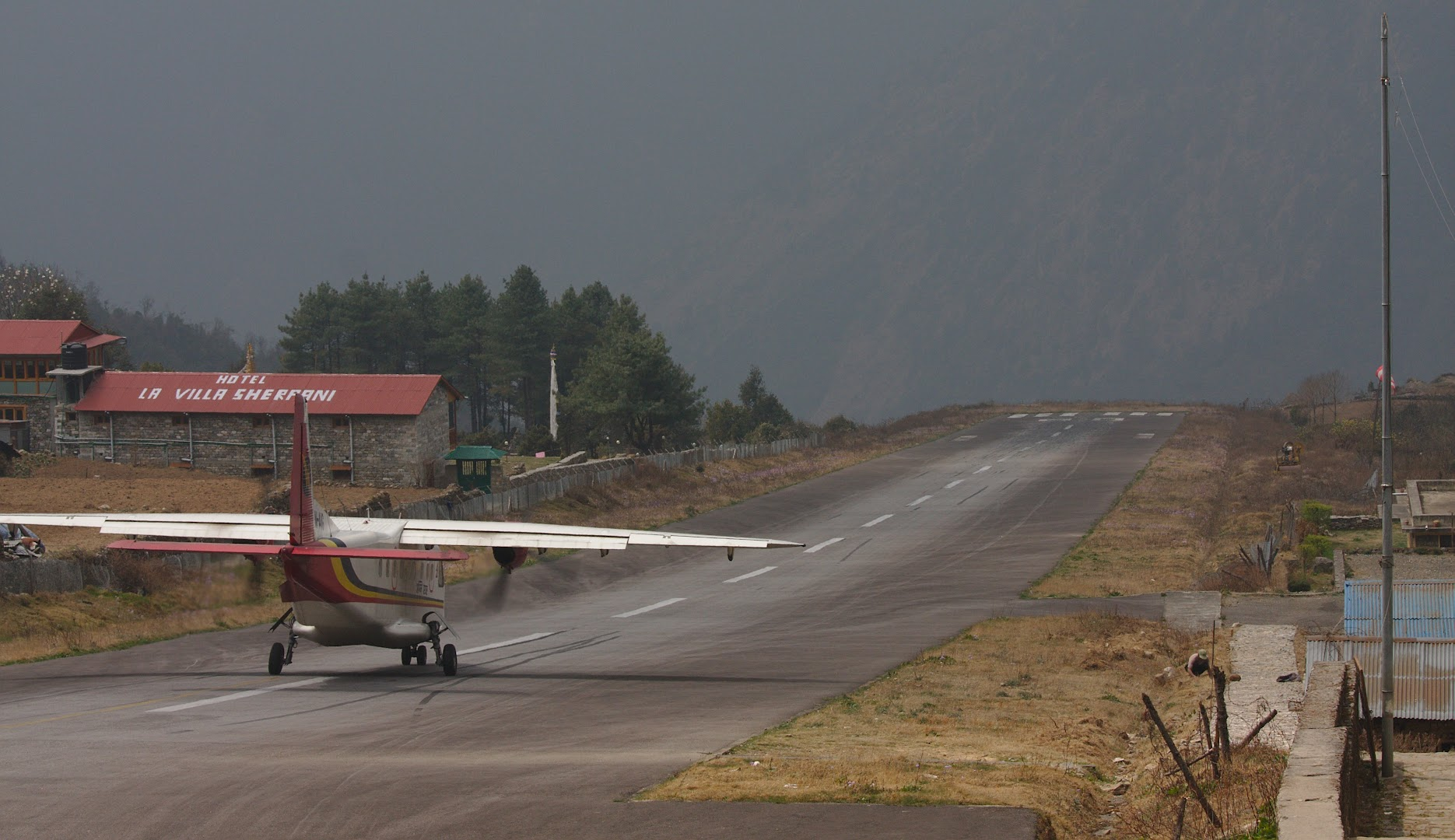 Lukla airfield has quite big incline, planes land going up and lift going down