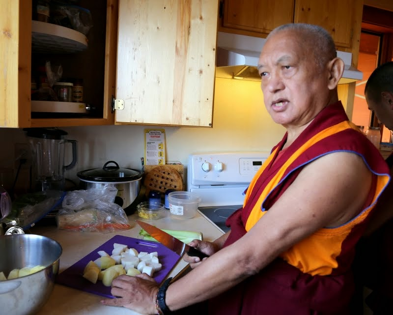 Lama Zopa Rinpoche showing how to make shemda – potato, radish, mushroom, ping noodles and rice – which will be the main dish offered on the Amitabha Buddha celebration day that Rinpoche planned, Buddha Amitabha Pure Land, Washington, US, August 2014. Photo by Ven. Thubten Kunsang.