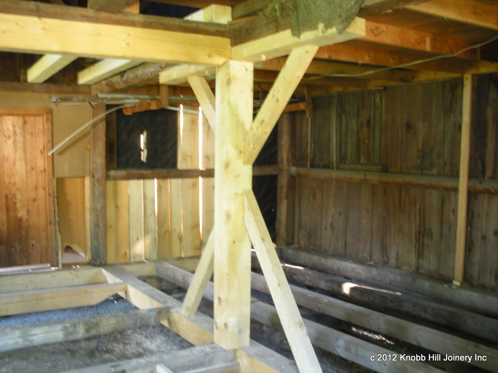 The new sill system, center post and lintel in place with an additional lintel for the main floor girt.