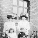 Gwen Greenough as a child with mother, and wife and child of the porter at Upton Station