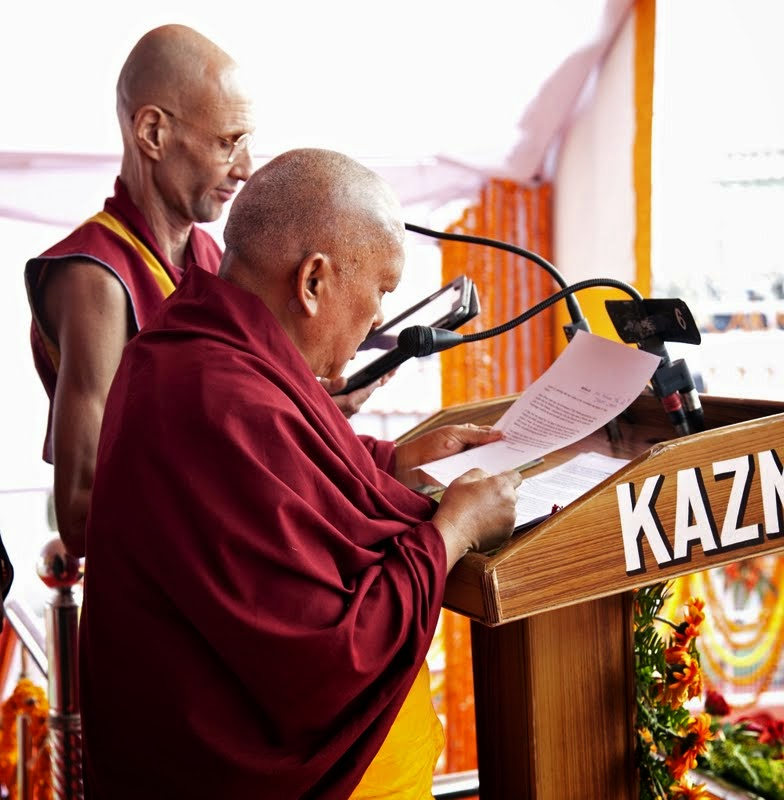 Lama Zopa Rinpoche speaking at ceremony with Ven. Kabir Saxena providing interpretation, Kushinagar, India, December 13, 2013. Photo by Andy Melnic.
