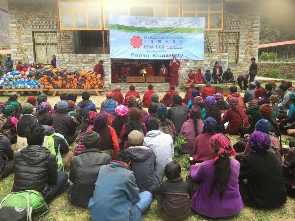 Villagers preparing to receive temporary shelter supplies.