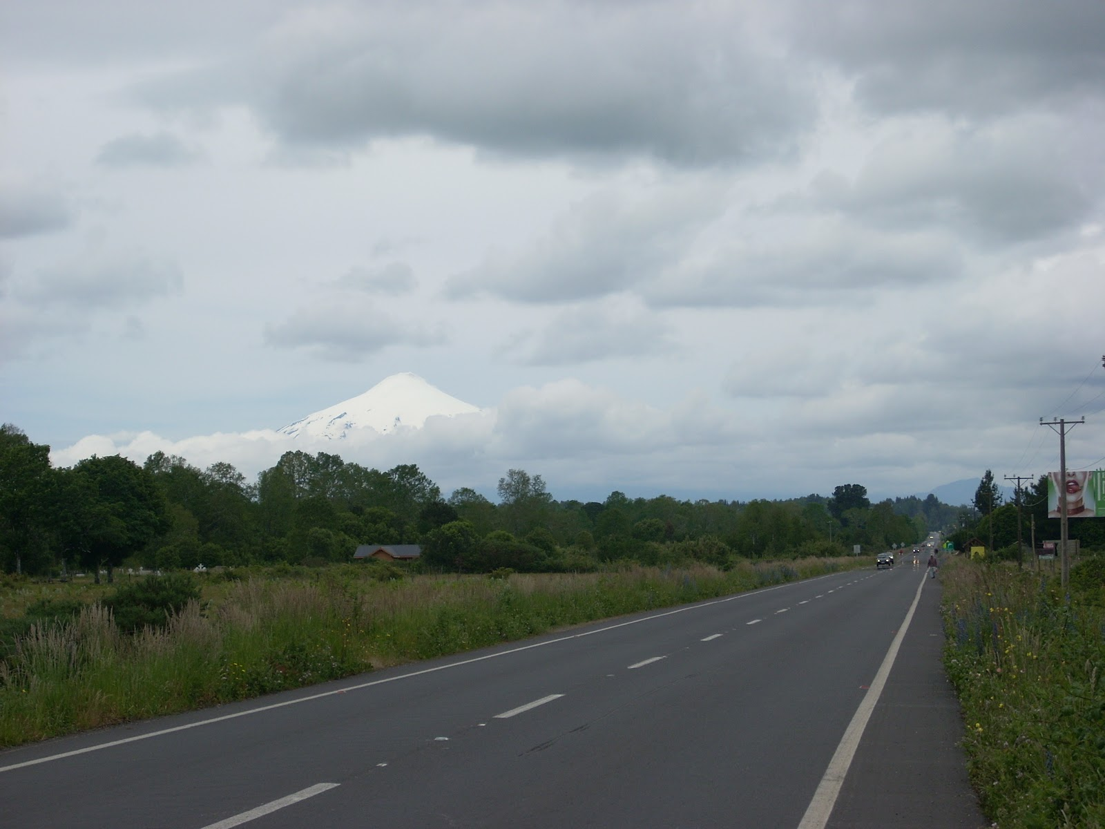 And onto this road. The last day of easy riding. Note the smooth shoulder. This will all just be a dream soon. The volcano is peeking through in the distance