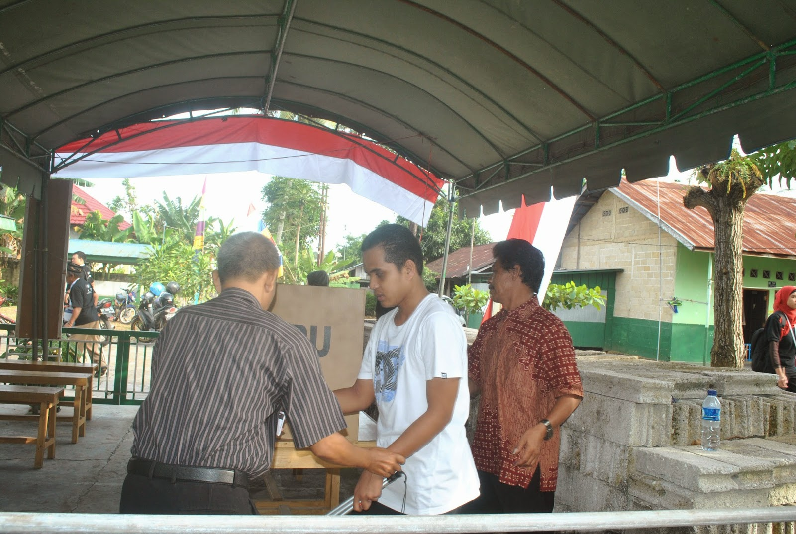 Visual impaired voter with assisstant in Central Java