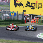 Fernando Alonso, Renault R26 battles with Michael Schumacher, Ferrari 248 F1