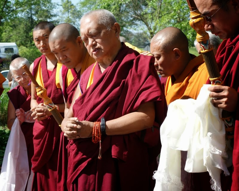 Lama Zopa Rinpoche blessing the Kadampa stupa at Kadampa Center, Raleigh, North Carolina, US, May 3, 2014. Photo by Ven. Roger Kunsang.